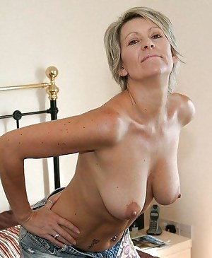 Licking her own nipples